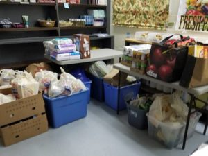 Food donations in bins and in bags.