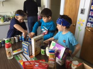 Students count food items for the 100th day of school