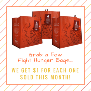 """Three """"Hannaford Helps"""" bags with a note to grab a few bags when shopping for $1 donation for each purchase."""