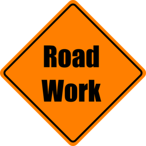 Orange road sign for Road Work