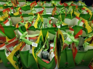 Reusable bags packed with Thanksgiving dinner fixings