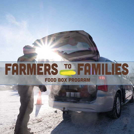 Farmers to Families showing a person loading food into the trunk of a car.