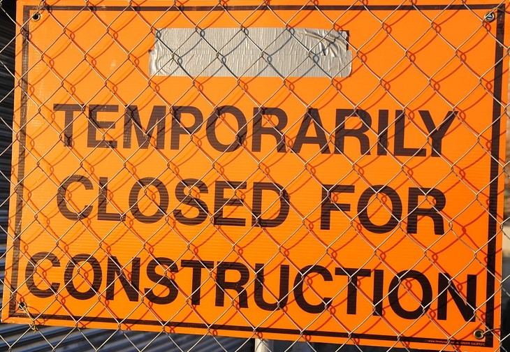 """Orange sign that reads, """"Temporarily closed for construction."""""""